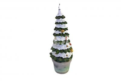 A christmas tree-shaped candle - A christmas tree-shaped candle isolated on white