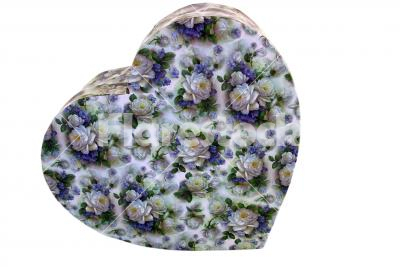 A heart-shaped box - A heart-shaped cardboard box with rose patterns isolated on white