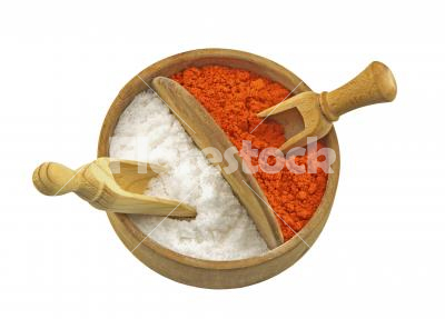 Double container for salt and paprika - Salt and paprika in a wooden container isolated on white background