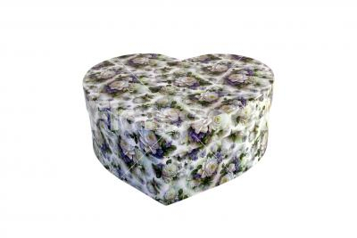 Heart-shaped box isolated on white - A heart-shaped cardboard box with rose patterns