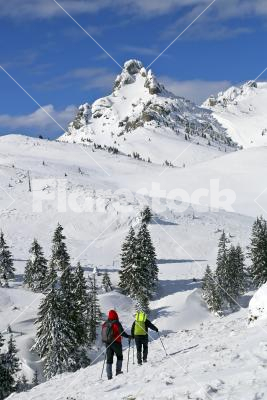 Hikers on a hill - Hikers on a snow-covered mountain