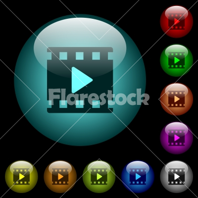 Movie play icons in color illuminated glass buttons - Movie play icons in color illuminated spherical glass buttons on black background. Can be used to black or dark templates