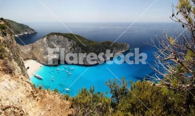 Navagio bay - Zakynthos - panoramic image - A panoramic image about this beautiful bay in Zakynthos, Greece. These are the real tones, so this bay is incredibly blue and azure!