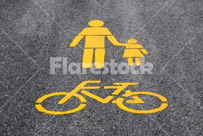 Road mark - Yellow bicycle road sign painted on the asphalt