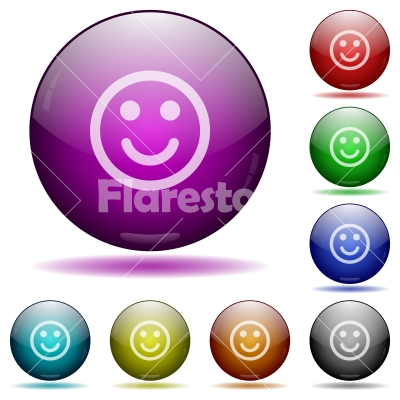 Smiling emoticon glass sphere buttons - Smiling emoticon color glass sphere buttons with shadows.