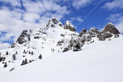 Snowy peak - The snowy and rocky peak of a mountain