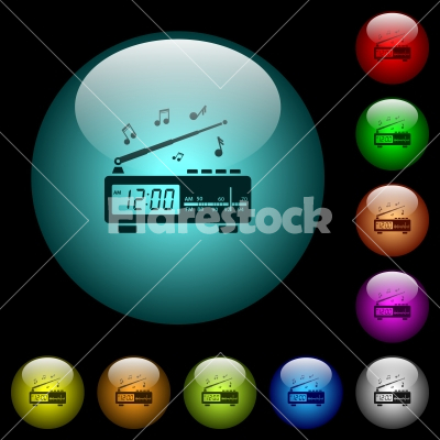 Vintage radio clock with music icons in color illuminated glass buttons - Vintage radio clock with music icons in color illuminated spherical glass buttons on black background. Can be used to black or dark templates