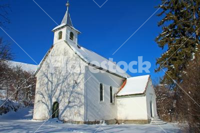 White church - Little white church standing in the winter sunshine