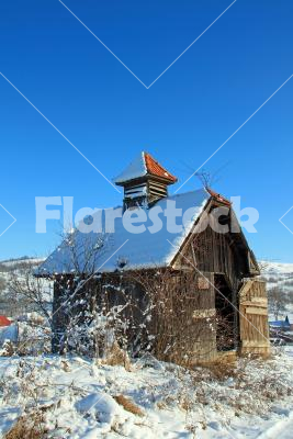 Wooden barn - A lonely wooden barn on the winter meadow