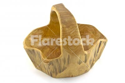 Wooden basket -  A little carved wooden basket isolated on white background